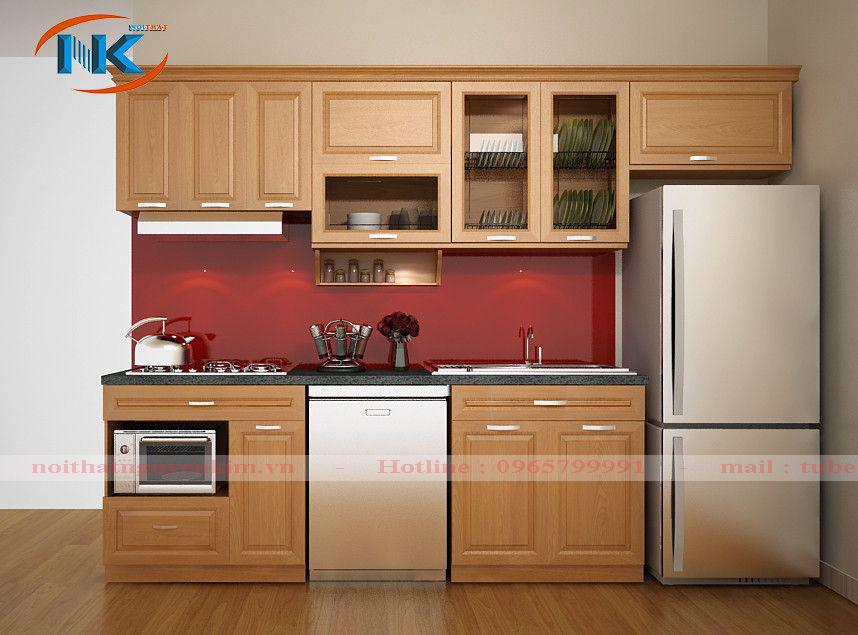 Mẫu tủ bếp xoan đào chữ I này có thêm khoang chứa tủ lạnh, thuận tiện cho hoạt động nấu nướng hàng ngày