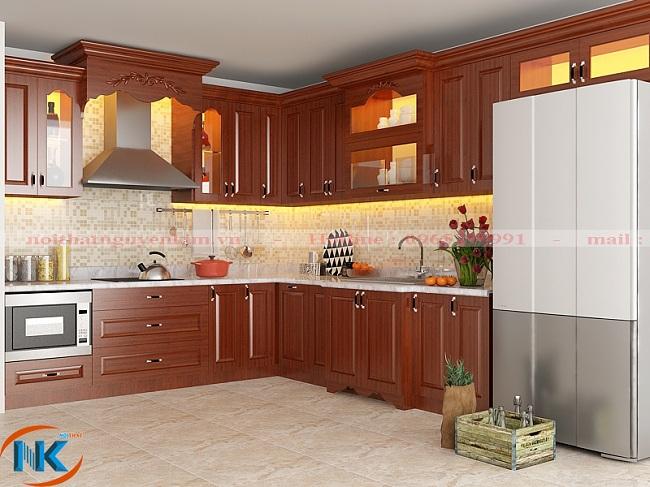 Thêm một thiết kế tủ bếp gỗ xoan đào chữ L cho phòng bếp rộng rãi, thông thoáng với đầy đủ tiện nghi hiện đại