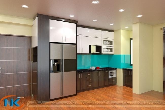 Tủ bếp acrylic chữ L vừa vặn với diện tích bếp chung cư. Thiết kế kịch trần gia tăng diện tích sử dụng của tủ bếp