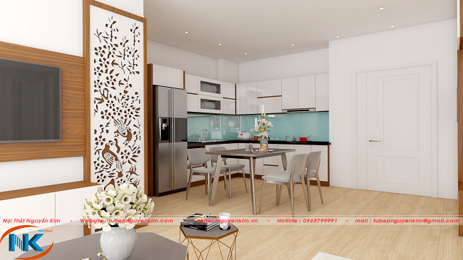 Góc nhìn căn bếp từ phòng khách vô cùng ấn tượng bởi màu trắng bóng gương của chất liệu gỗ acrylic