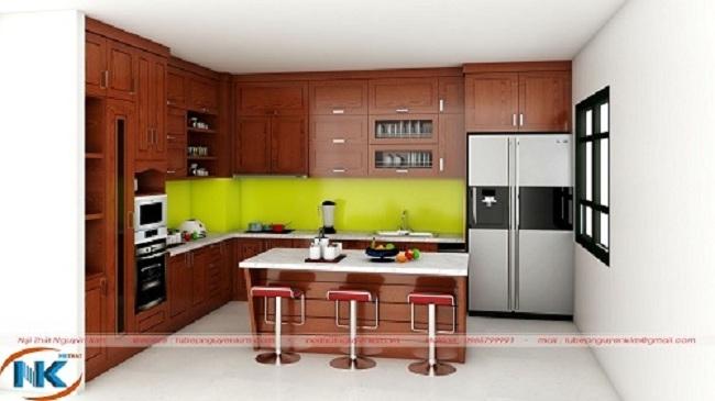 Tủ bếp gỗ xoan đào mang phong cách hiện đại kết hợp với bàn đảo soạn đồ thông minh, tối đa chức năng sử dụng