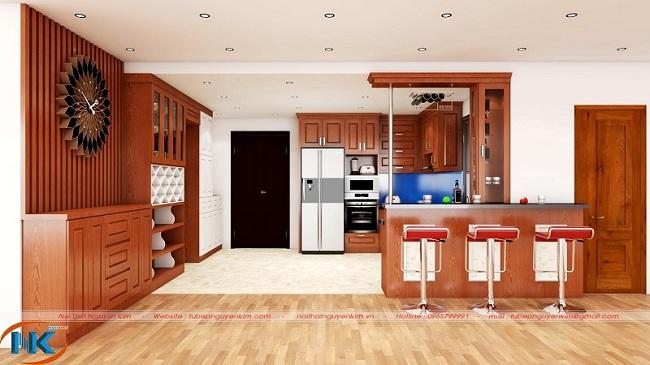 Nhìn mẫu tủ bếp gỗ xoan đào chữ L hiện đại, sang chảnh hơn với quầy bar, tủ rượu thiết kế theo phong cách hiện đại