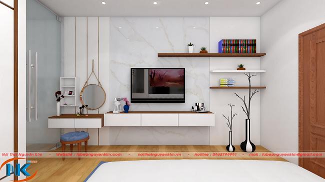 Không gian phòng ngủ đẹp hơn với cách trang trí khu vực tivi, kệ rất đơn giản mà sang chảnh