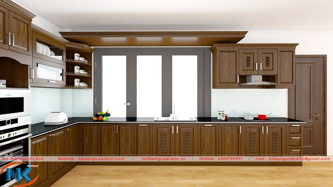 Mẫu tủ bếp gỗ sồi nga hiện đại mang tới không gian bếp rộng rãi. Thiết kế chữ L tận dụng tối đa diện góc bếp và nổi bật hơn cả được sơn màu nâu của gỗ óc chó