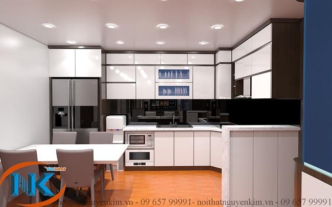 Tủ bếp acrylic chữ L màu trắng bóng gương cho căn bếp chung cư khá rộng
