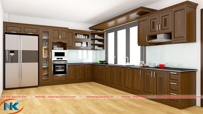 Phòng bếp rộng rãi sử dụng mẫu tủ bếp chữ L màu nâu vô cùng lôi cuốn, tạo chiều sâu không gian chung