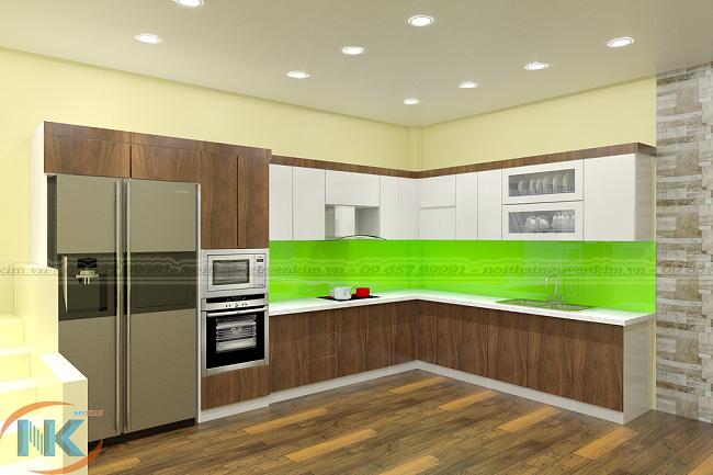Màu vân gỗ kết hợp màu trắng sáng khá ấn tượng cho mẫu thiết kế tủ bếp chữ L này