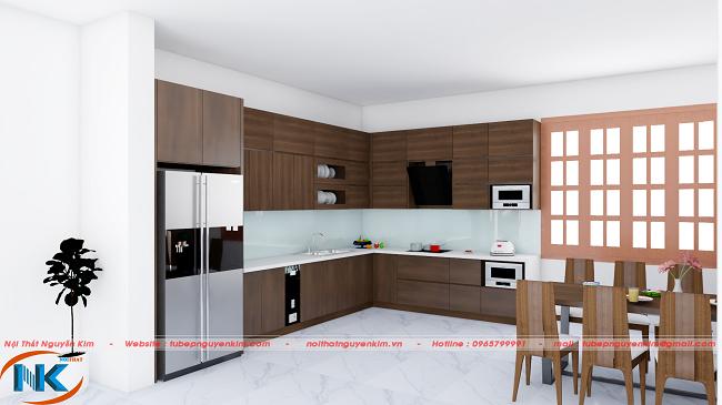 Kiểu dáng chữ L rộng rãi cùng màu vân gỗ nâu đậm rất sang trọng cho phòng bếp nhà biệt thự